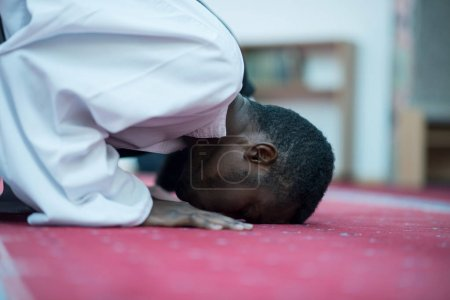Two religious muslim men praying