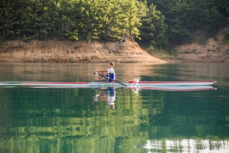 A Young rowing competitor on lake