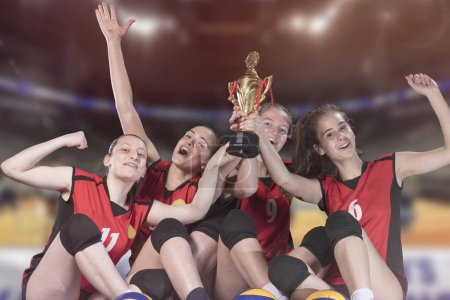 Photo for Woman volleyball Players celebrating victory and gold medal. - Royalty Free Image