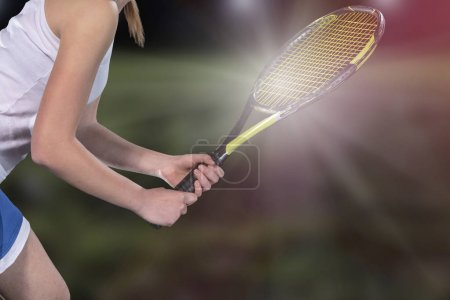 Photo for Woman playing tennis and waiting for the service. - Royalty Free Image