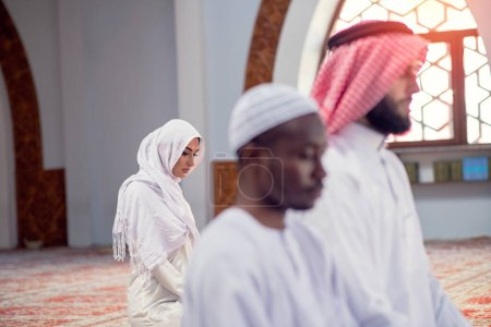 Photo for African Muslim Couple Praying inside of beutiful mosque. - Royalty Free Image