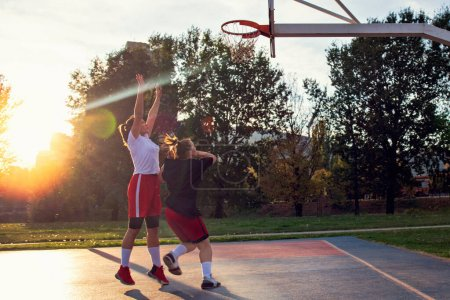 Photo for Woman basketball player have treining and exercise at basketball court at city on street. - Royalty Free Image