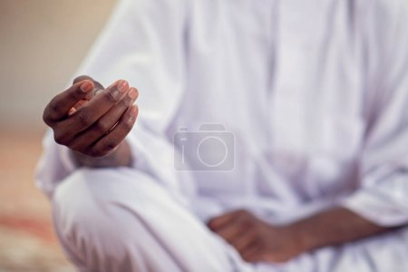 Photo for Religious black muslim man praying inside the mosque. - Royalty Free Image