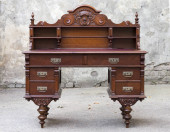 Antique wooden mahogany writing desk with wood carvings
