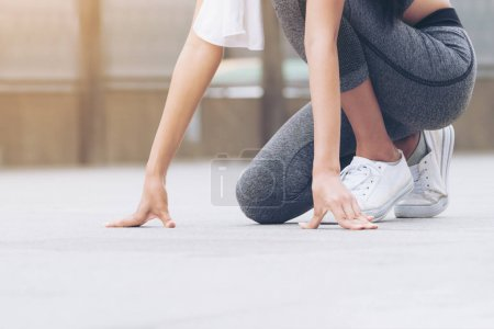 Photo for Sport woman runner in starting run position, ready to start running. - Royalty Free Image