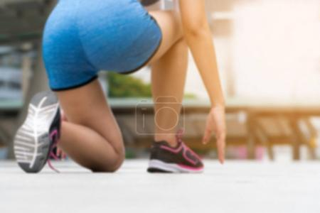 Photo for Blurred background of woman runner in starting run position. - Royalty Free Image